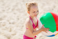 Happy little girl playing inflatable ball on beach Royalty Free Stock Photo