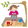Happy little girl playing on the sandpit, building sand castle Royalty Free Stock Photo