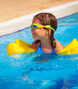 Happy little girl in the pool closeup portrait of swimming active childhood having fun outdoors summer holidays floating clear Royalty Free Stock Photos