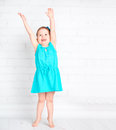 Happy little girl raised her hands up and measure your height shows that increased Royalty Free Stock Image