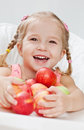 Happy little girl with red apple