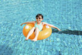 Happy little girl relaxing and swimming in the pool Royalty Free Stock Photo