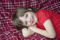 Happy little girl resting in a bed Stock Photo