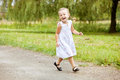 Happy little girl running on road Royalty Free Stock Images