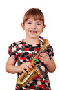 Happy little girl with saxophone Royalty Free Stock Photos