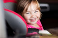 Happy little girl sitting in baby car seat Royalty Free Stock Photo