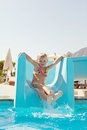 Happy little girl on slide Royalty Free Stock Image