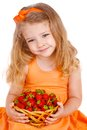 Happy little girl with strawberries this image has attached release Stock Images