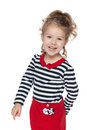 Happy little girl in the striped blouse a portrait of a against white background Royalty Free Stock Photo