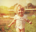 Happy little girl in summer sunlight vintage paper textured Stock Photo