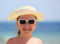 Happy little girl in sunglasses on beach portrait of cute and hat Royalty Free Stock Photo