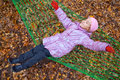 Happy little girl swinging hammock autumn forest Stock Photo