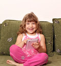 Happy little girl with tablet pc Stock Photography
