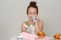 Happy little girl tea party with grey background Stock Photography