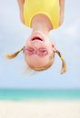 Happy little girl upside down Stock Photography