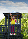 Happy little girl wooden tower playground Royalty Free Stock Images