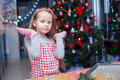 Happy little girl in wore mittens baking christmas gingerbread cookies this image has attached release Royalty Free Stock Images