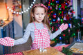 Happy little girl in wore mittens baking christmas gingerbread cookies this image has attached release Stock Photography