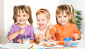 Happy little girls in kindergarten draw paints sister Stock Photo