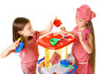 Happy little girls play cooking two charming with toys Stock Photos