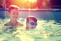 Happy little kid learn swimming with brother vintage style