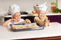 Happy little kids made pizza successfully in the kitchen Stock Image