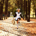 Happy little schoolgirl go home from school Royalty Free Stock Photo