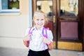 Happy little schoolgirl portrait near school Royalty Free Stock Photo