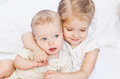 Happy little sister hugging her brother Royalty Free Stock Photo