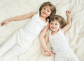 Happy little sisters lying top view on back Royalty Free Stock Photography