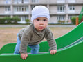 Happy little toddler boy having fun sliding on playground Royalty Free Stock Photo