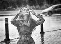 Happy long hair girl enjoying the rain drops in the park Royalty Free Stock Photo