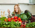 Happy long-haired woman cooking with heap of  vegetables Royalty Free Stock Photo