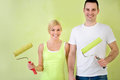 Happy love couple with equipment for painting young lovers smiling and holding Stock Photography