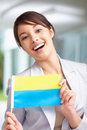 Happy lovely woman holding a Ukraine flag Stock Photography