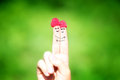 Happy loving couple of fingers with raspberries and painted smil Royalty Free Stock Photo