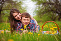 Happy loving couple on a spring meadow Royalty Free Stock Photo