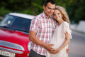 The happy loving couple travels in the red car Royalty Free Stock Photo