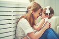 Happy loving family. mother and child playing, kissing and hugg Royalty Free Stock Photo