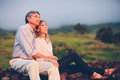 Happy loving middle aged couple romantic moment watching the sunset in the countryside Stock Photos