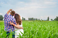 Happy loving young adult couple spending time on the field on sunny day Royalty Free Stock Photo