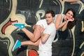 Happy loving young couple outdoors pretty having fun men piggybacking his pretty girlfriend Stock Photo