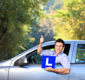 Happy male in car holding a L sign Royalty Free Stock Photos