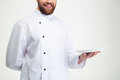 Happy male chef cook holding empty plate Royalty Free Stock Photo