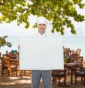 Happy male chef cook holding white blank big board Royalty Free Stock Photo