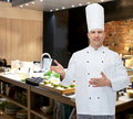 Happy male chef cook inviting cooking profession and people concept Stock Photography