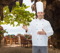 Happy male chef cook inviting cooking profession and people concept over restaurant lounge on beach Stock Photography