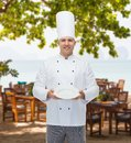 Happy male chef cook showing empty plate Royalty Free Stock Photo