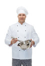 Happy male chef cook whipping something with whisk Royalty Free Stock Photo