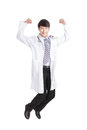 Happy male doctor jumping and smiling excited young medical professional isolated on white background Royalty Free Stock Image